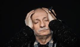 Nahaufnahmeporträt eines alten Mannes Stockbild