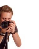 Nahaufnahmeporträt eines jungen Mannes, der ein Foto von der Ecke macht Stockfoto