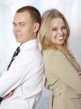 Nahaufnahmeportrait der glücklichen jungen Geschäftsleute Stockfotografie