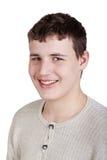 Nahaufnahmeportrait des lächelnden Hälfte-gedrehten jugendlich Jungen Stockbilder