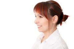 Nahaufnahmeprofil der lächelnden jungen Frau Stockfotos