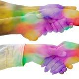 Nahaufnahmeschüsse des Händedrucks mit bunten Bildüberlagerungen Lizenzfreies Stockfoto