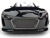 Nahaufnahmeschuß der Vorderansicht des glänzenden samtschwarzen modernen Cabriolet super Motor- extremer lizenzfreie abbildung