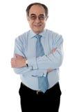 Nahaufnahmeschuß des lächelnden gereiften Geschäftsmannes stockfotos