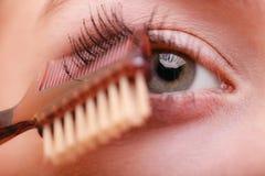 Nahaufnahmeteil des Frauengesichtsaugen-Make-updetails Stockfotos