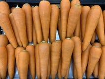 Nahe oben organische Karotte für Nahrungsmittelhintergrund stockbilder