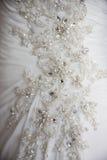 Nahes Detail über Hochzeitskleid Lizenzfreie Stockfotos