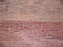 Nahes hohes der Backsteinmauer Stockfotografie