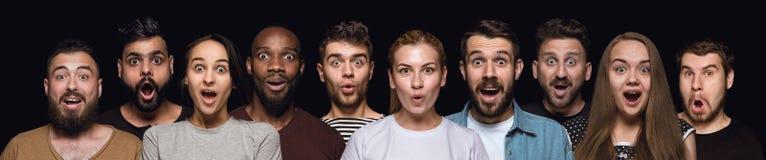 Nahes hohes Porträt von den jungen Leuten lokalisiert auf schwarzem Studiohintergrund lizenzfreie stockfotos