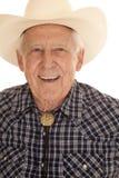 Nahes Lächeln des älteren Manncowboys Stockfoto