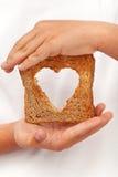Nahrung mit Liebe lizenzfreie stockbilder