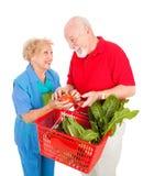 Nahrungsmitteleinkaufen-Spaß stockbilder