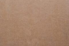 Nahtlose Beschaffenheit des braunen Papiers und Papphintergrund Lizenzfreie Stockbilder