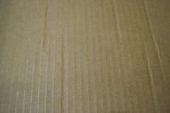 Nahtlose Beschaffenheit des braunen Papiers und Papphintergrund Stockbild