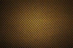 Nahtlose Beschaffenheit des goldenen Kohlenstoff-Faser-Stoffes stockbild