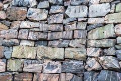 Nahtlose rechteckige Granitfelsen der Steinmaurerarbeit rot und graue Schatten, natürliches Muster, Hintergrund lizenzfreies stockbild