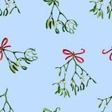 Nahtloser Aquarell Weihnachtshintergrund mit Mistelzweig und rotem Band Stockbilder