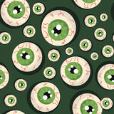 Nahtloser grüner Hintergrund mit Augen Stockbilder