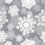 Nahtloser Hintergrund des Winters mit Schneeflocken Winterurlaub- und Weihnachtshintergrund Lizenzfreie Stockfotografie