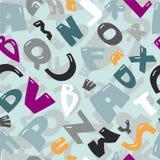 Nahtloser Hintergrund mit Buchstaben des lateinischen Alphabetes Stockfotografie