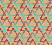 Nahtloser Hintergrund mit Dreiecken in der Hippie-Palette Stockbilder
