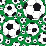 Nahtloser Hintergrund mit Fußballkugeln. Stockfotografie