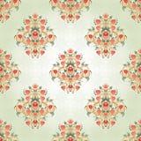 Nahtloser Hintergrund mit symmetrischen mit Blumenelementen Stockfoto
