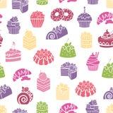 Nahtloser Musterhintergrund der Kuchen und der Bonbons Lizenzfreie Stockfotografie