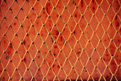 Nahtloser roter Maschendraht Stockfotografie