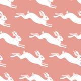 Nahtloses Kaninchenmuster zu Ostern-Feiertag Auch im corel abgehobenen Betrag Stockbild