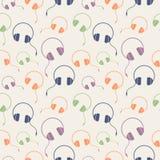 Nahtloses Musikvektormuster, chaotischer Hintergrund mit bunten Kopfhörern Stockfotos