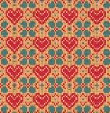 Nahtloses Muster auf dem Thema des Valentinstags mit einem Bild der Norwegermuster und -herzen Wolle gestrickt Lizenzfreie Stockfotografie