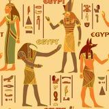 Nahtloses Muster der Weinlese mit ägyptischen Göttern und alten ägyptischen Hieroglyphen Stockbilder