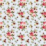 Nahtloses Muster der Weinlese mit rosa Rosen auf Blau Auch im corel abgehobenen Betrag Stockfotos