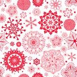 Nahtloses Muster des Winters mit roten Schneeflocken Lizenzfreies Stockfoto