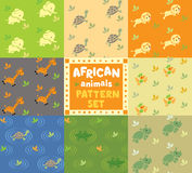 Nahtloses Muster eingestellt mit lustigen afrikanischen Tieren Lizenzfreie Stockfotos