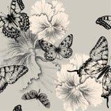 Nahtloses Muster mit blühenden Pansies und butterf Lizenzfreie Stockfotografie
