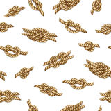 Nahtloses Muster mit gelben Seilen und Marineknoten über weißem Hintergrund Stockbild