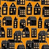 Nahtloses Muster mit Häusern in Schwarzem und in Orange lizenzfreie abbildung