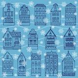 Nahtloses Muster mit Häusern und Flocken des Schnees Stockfotografie