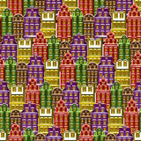 Nahtloses Muster mit Häusern Fliese wenig Stadthintergrund Packpapierbeschaffenheit mit Mehrfarbengebäuden Vektor veranschaulicht Stockfotos