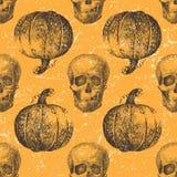 Nahtloses Muster mit Kürbis und dem Schädel Stockbilder