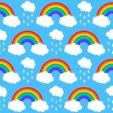 Nahtloses Muster mit Regenbogen und Wolken auf einem Blauen