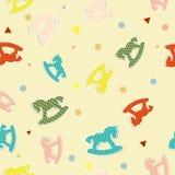 Nahtloses Muster mit Schaukelpferden Stockbild