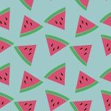 Nahtloses Muster mit Scheiben der Wassermelone auf dem blauen Hintergrund Lizenzfreie Stockbilder