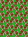 Nahtloses Muster von Bällen des amerikanischen Fußballs auf dem Gras Lizenzfreie Stockbilder