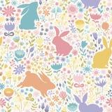 Nahtloses Muster von mehrfarbigen Schattenbildern von Kaninchen und wild Lizenzfreie Stockfotos