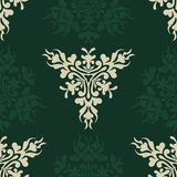 Nahtloses Retro- heraldisches Muster auf Grün Stockfotografie