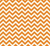Nahtloses Vektormuster des orange und weißen Zickzacks lizenzfreie stockfotos