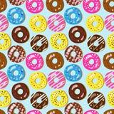 Nahtloses Vektormuster von sortierten Donuts mit unterschiedlicher Spitze Stockfotografie